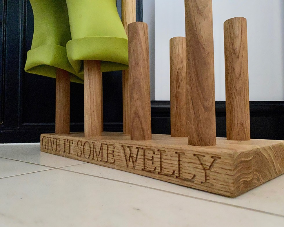 solid oak welly rack for 8 pairs, 4 adult and 4 child engraved along the front edge of the base with give it some welly