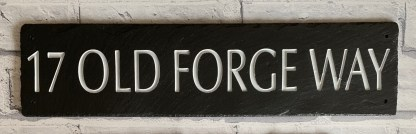 long piece of handcut welsh grey slate engraved with 17 old forge way all in large capital letters
