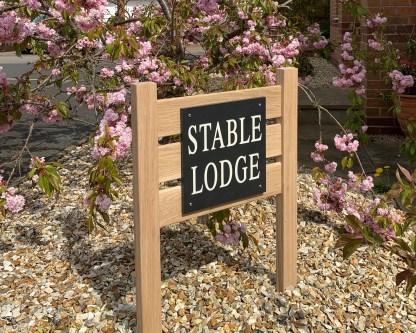 slate and oak ground fixed house sign