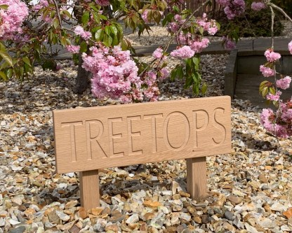 solid oak ground fixed low level house sign, with an oak board engraved and fixed to two posts