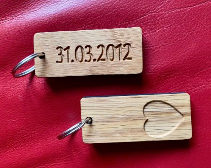 solid oak keyrings with engraved heart design and date