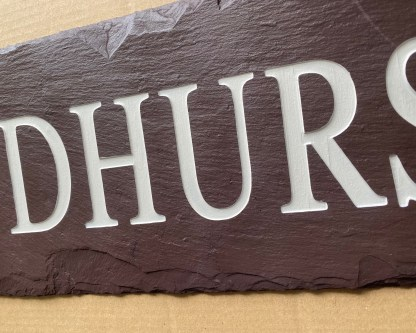 long piece of handcut welsh heather slate engraved with lyndhurst designed for use as a house sign