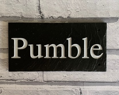 slate stable sign engraved with upper and lower case characters