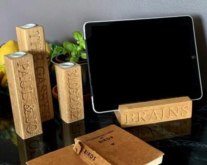 slate&oak. solid oak tablet dock with brains engraved along the front edge