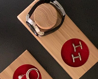 aerial view of watch and cufflink tray showing the detail of the design