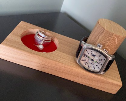 close up of watch and cufflink/jewellery tray with watch in situ over the vertical post