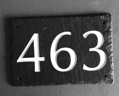 black slate house sign engraved with numbers 463 which are painted white and finished with a matt sealer. drill holes in each corner for fixing