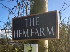 engraved slate house sign fixed to a solid oak back board and mounted on a telegraph pole on the customer's property. shown in situ