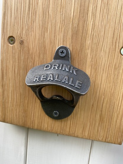 cast iron bottle opener embossed with drink real ale