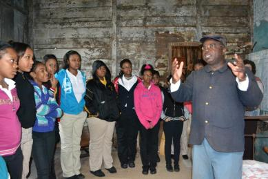 Joseph McGill with a group of students (image from The Slave Dwelling Project)