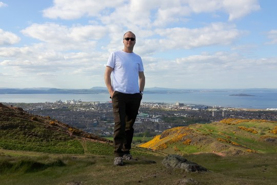 DJ Munro on Arthur's Seat, with Leith in the background.