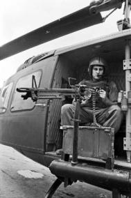 A Member of the RAN Helicopter Flight Vietnam (RANHFV) Seated in a Huey Helicopter