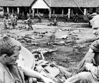 Bodies of Vietnamese Army Troops Laid Out in an Open Area to be Checked for Documents Before Burial