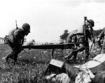 Medics Carry the Body of a Dead South Vietnamese Officer