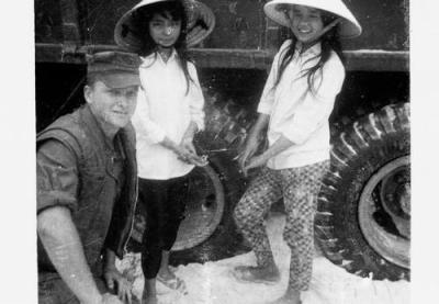 Soldier Poses With Two Local Vietnamese Girls