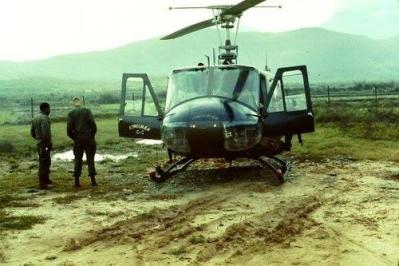 Soldier and Pilot Wait at a Landing Zone