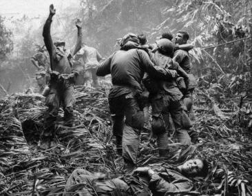 Soldiers Helping Soldiers During a Fire Fight in Hue, Southern Vietnam
