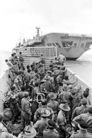 Troops Travel On Landing Craft To Board HMAS Sydney For Their Trip Home