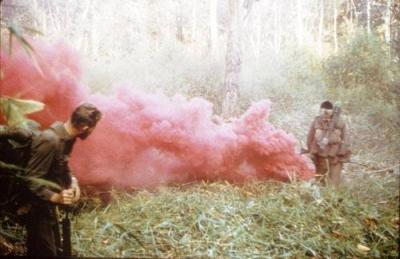Two Members of V-Company Use Smoke to Signal Location of Wounded During Operation Coburg
