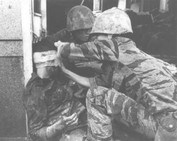 Vietnamese Marine Receives First Aid From a U.S. Marine Medic
