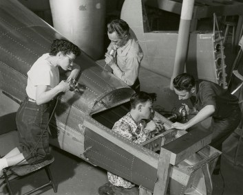 Instructor And Students Riveting Airplane Fuselage