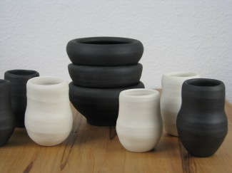 From a new series, featuring bare clay, polished to river rock smoothness: Shot in the Dark and Lit Up shot/sake cups with coordinating finger bowls (black stoneware and porcelain).