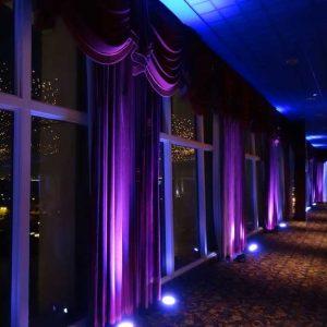 wedding uplights shining on curtains