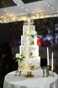 Gold covered wedding cake with spotlights on it