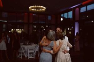 utah bride and groom hug mothers after special dance