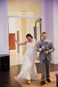bride and groom coming into room for grand entrance