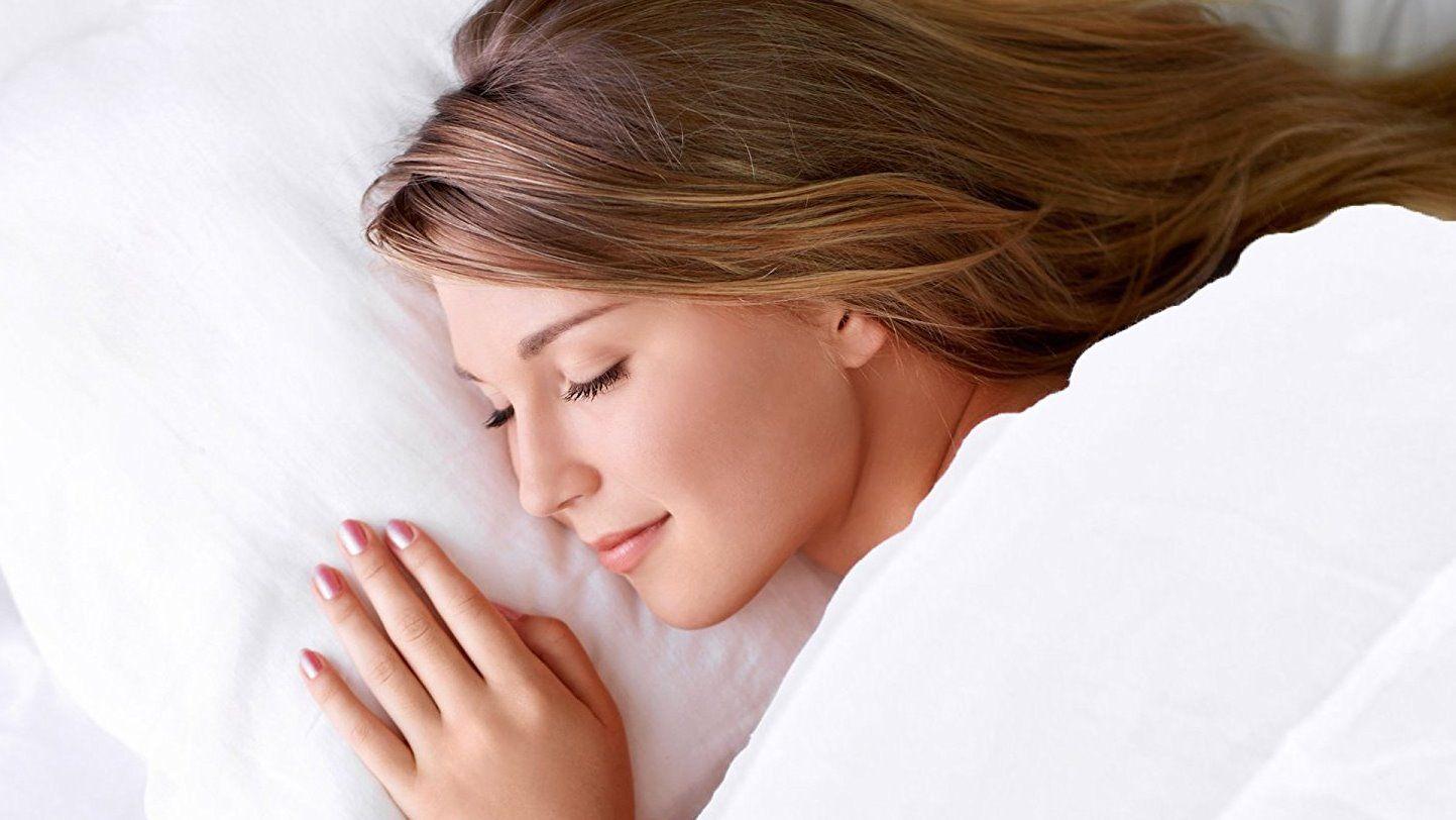 sleeping woman on mattress topper