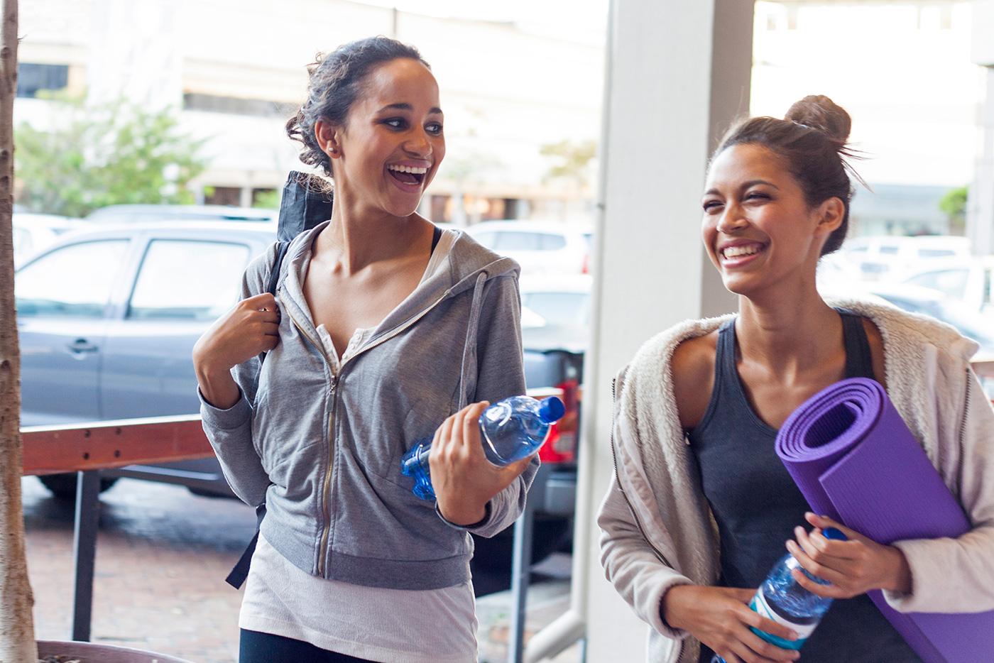 Two women walking, going to yoga class
