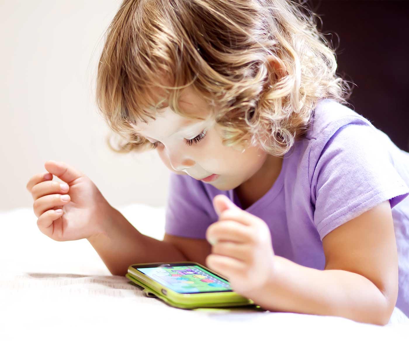 A little girl with a smart phone, redirecting children's behavior