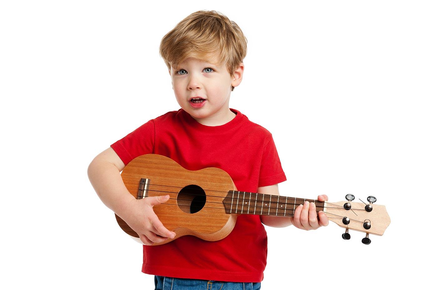Toddler boy playing guitar