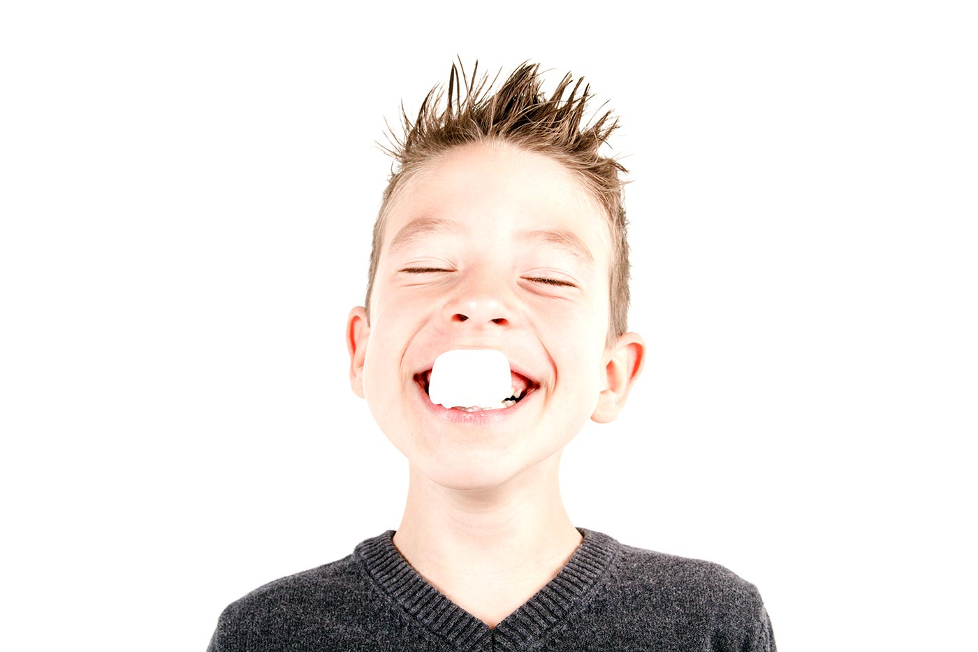 Boy eating a marshmallow
