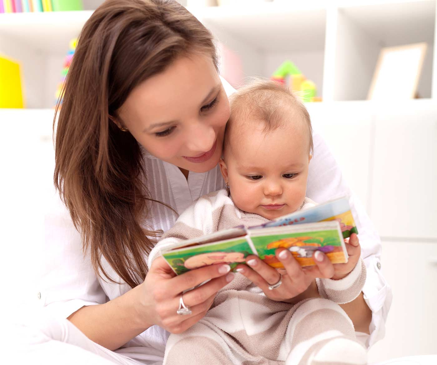 Mom reading a book to her baby