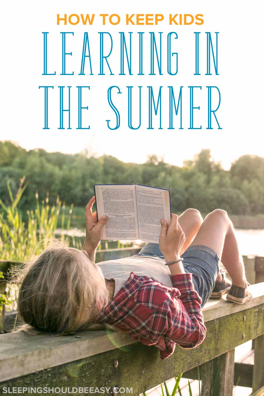 Child reading a book by a lake: How to keep your child learning in the summer