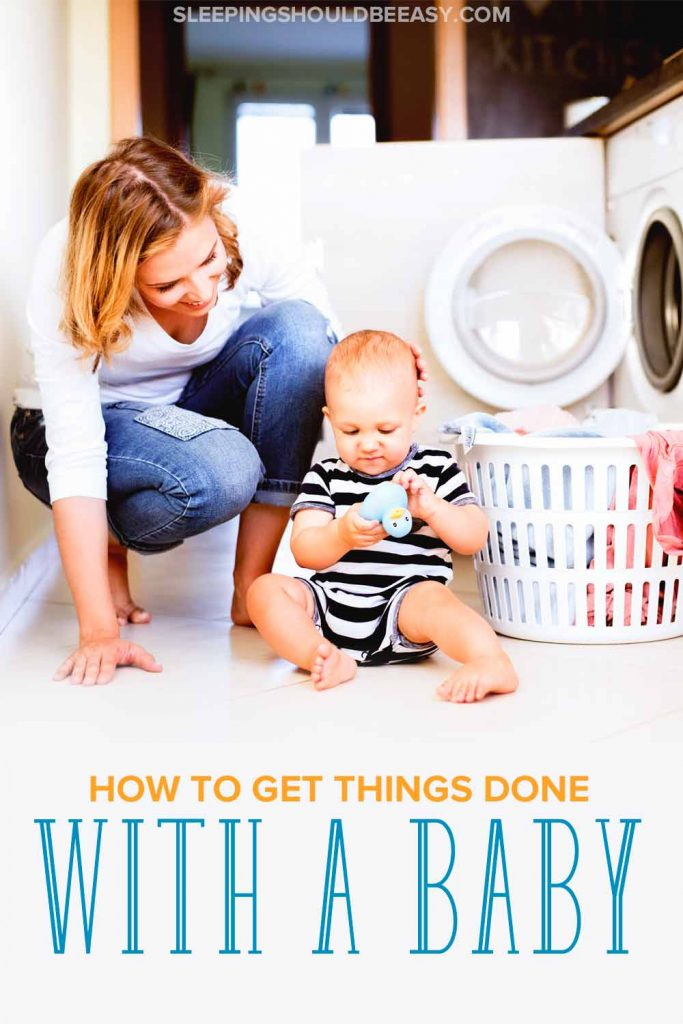 How to get things done with a baby: A mom with her baby and a laundry hamper