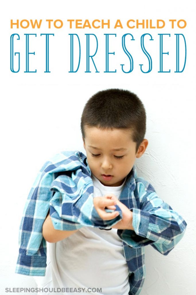 Little boy getting dressed: How to teach a child to dress themselves