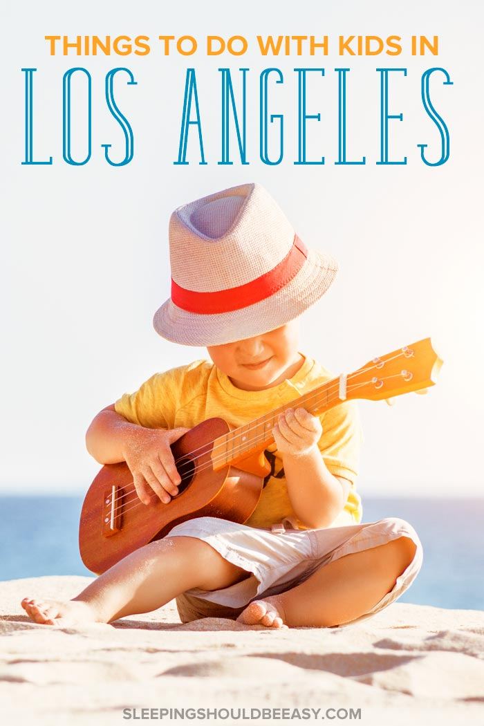 Things to do in Los Angeles with kids: A little boy playing the ukelele on the beach