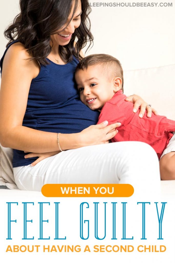 Pregnant mom with her toddler son, feeling second child guilt