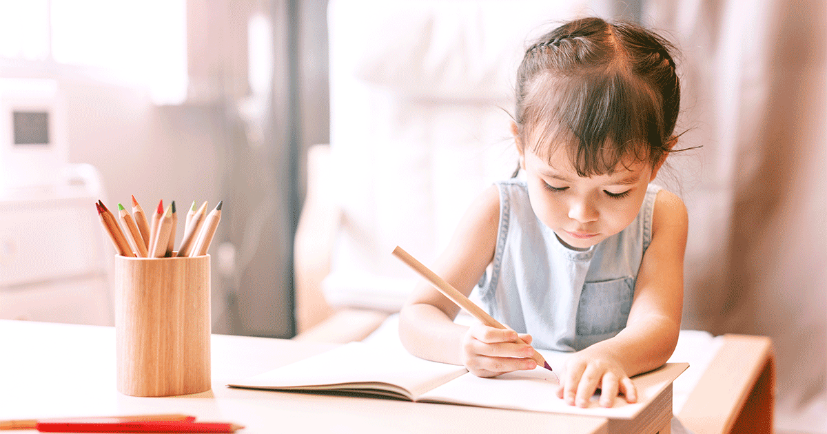 Little toddler writing independently