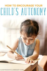 Little girl writing, developing autonomy in children