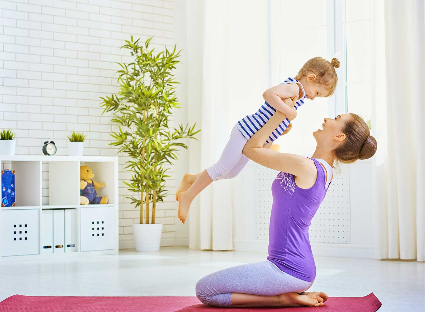 Mom exercising with her toddler