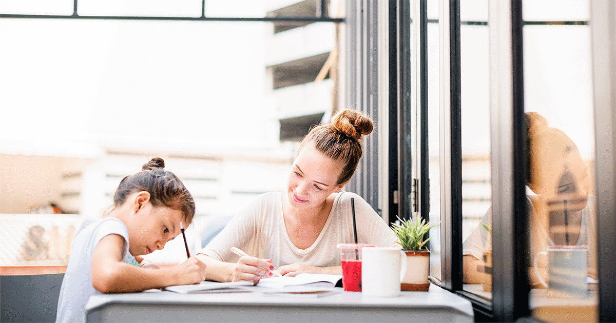Mom helping her daughter with math homework