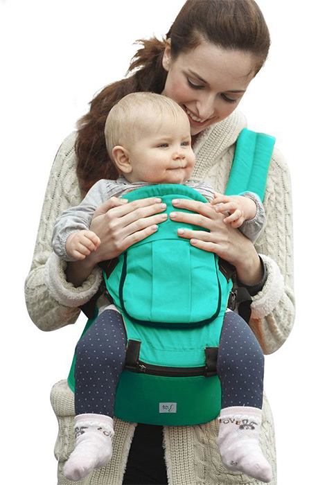 Mom carrying her baby in a baby carrier