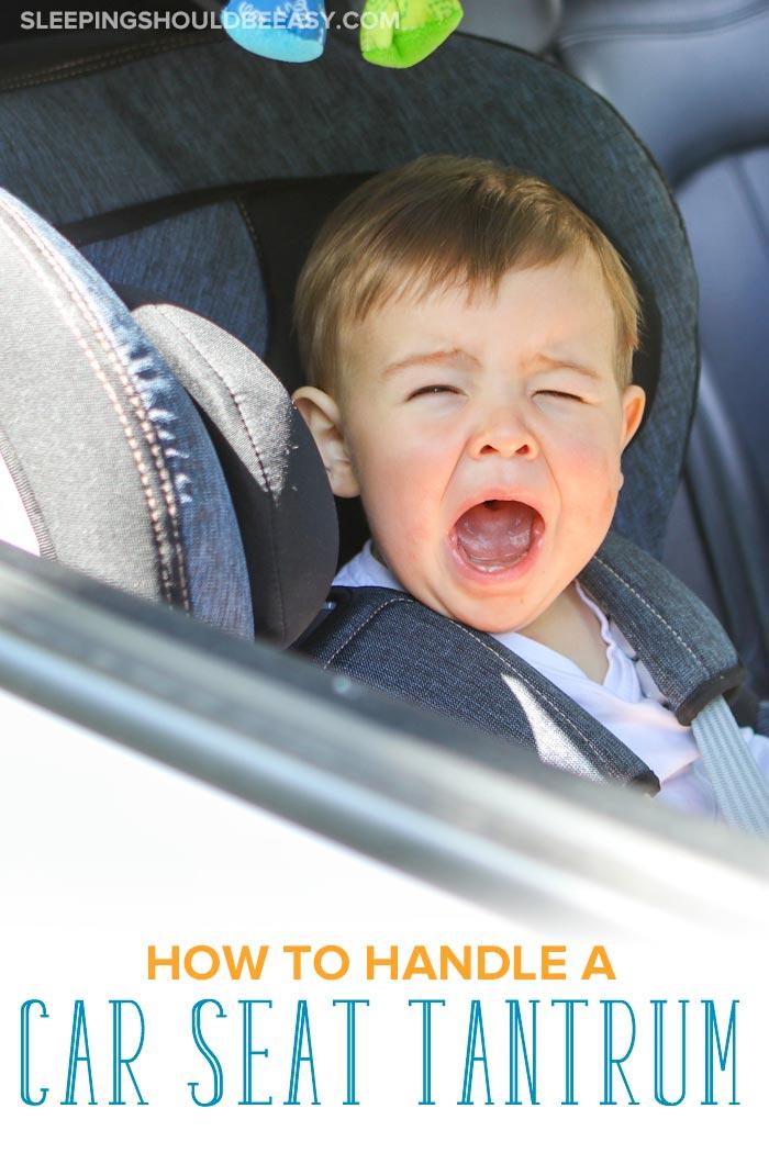 Little boy throwing a car seat tantrum