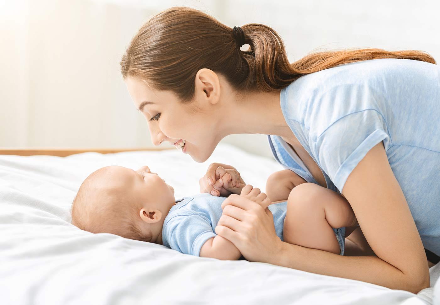 Mom admiring her newborn baby