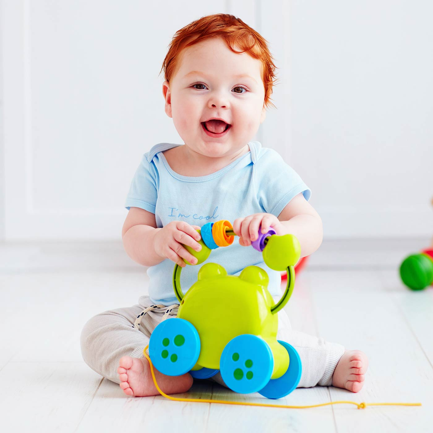 Toddler boy playing with a toy: playful activities for 1 year olds