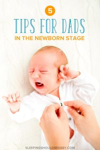 5 tips for dads in the newborn stage: dad's hands buttoning a baby's pajama